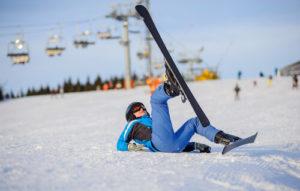 Girl falling from skiing